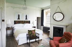 above the bedrooms at the farmhouse are hung with artworks from the couple s collection