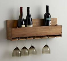 a wine rack with room for glasses that is wall mounted