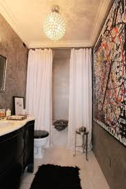 double up on your shower curtains so they part instead of slide also two ceiling height rods to include liner and shower curtain