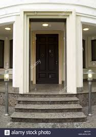 Granite steps leading up to large front door with porch Stock Photo ...