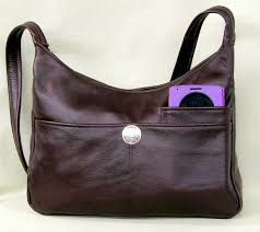 burdy leather handbag with silver concho enter quantity when new window opens medium 65 00 large 73 00 adjustable strap med 67 85