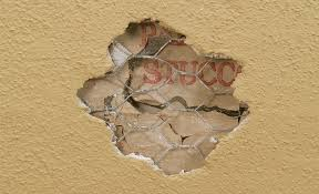 repair a hole on a stucco surface