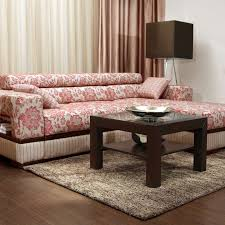 pink fl sectional sofa with square wooden table on brown carpet and brown wooden