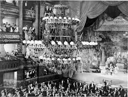 below the chandelier has fallen and people are trapped in panic