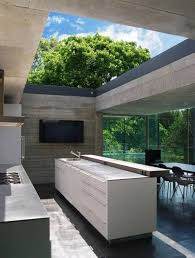 outdoor kitchen design long island. kitchens:stunning outdoor kitchen with long white counter also wood bench seat and table design island