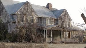 photo of dilapidated grey gardens