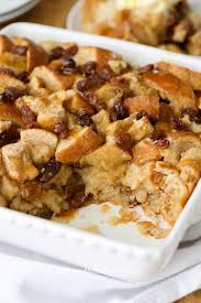 golden bread pudding in a white pan