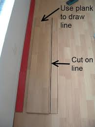 installing the last row of laminate flooring next i draw a line where i made