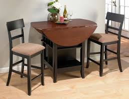 Unusual Cherry Round Dining Table with Leaf also Two Black Counter Height  Stools on Laminate Wooden