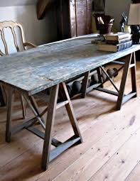 old door used as a table top with a trestle leg base would be great as a hs table for idea lab where hs students will spend apps 20 of their time