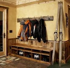 Boot Bench With Coat Rack This simple rustic bench allows for seating and storage of boots 24