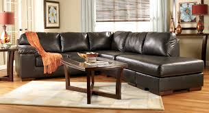 Furniture Black Leather Sofa And Dark Brown Wooden Table Also