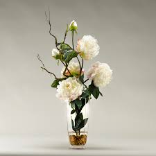 large white peonies in glass vase