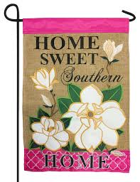 this southern style decorative garden flag combines gorgeous richly hued hot pink with a rugged burlap background and beautiful delicate looking magnolia