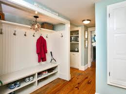 coastal mudroom with white built in bench