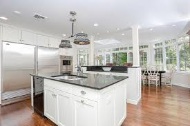 white kitchen with absolute black granite countertops