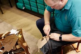 andy has prepared the shoes upper marking out incision points with a pair of dividers and a ing wheel he takes up his awl and cuts meticulously into