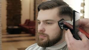 master makes beards correction in barbershop salon 4k stock fooe clip