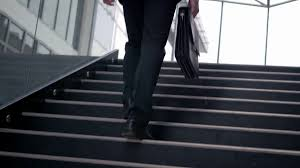 Office Stairs Young Ambitious Entrepreneur Walking Up The Stairs In A Modern