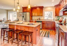 natural american cherry double shaker cabinets with giallo ornamental granite