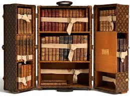 I generally have little use for couture in all its incarnations, but  Vuitton's combination steamer trunk and portable* library skewers me like  an arrow.