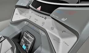 Faurecia's DeCo Control interior concept integrates interior controls into  the dashboard materials and decoration.