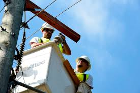 dennis wood l and casey allen of laclede electric cooperative help re power