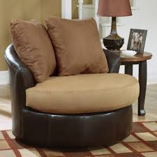 Swivel Chairs For Living Room Cool Oval Brown Leather Swivel Chairs With Arm And Two Pillows