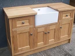 image of oak kitchen sink cabinet