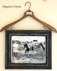 diy wood frames a vintage clothes hanger a painted and distressed wooden frame and eye