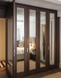mirror wardrobe. dark stained wood mirror wardrobe doors aren\u0027t excessive but still make the space look