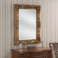 leaner ornate gold frame mirror