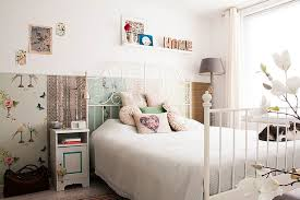 feminine bedroom furniture bed:  reusing materials is an essential component of this shabby chic bedroom design louise de