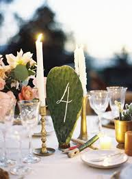 The nopal or cactus paddle table numbers are a unique signage and decor idea .