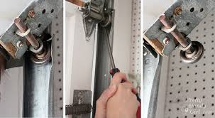 garage door off trackHow to Replace Garage Door Rollers  Pretty Handy Girl