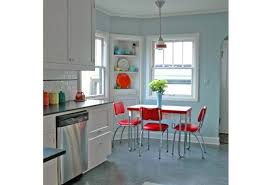 retro red and chrome kitchen table white subway tile blue walls white cabinets trim