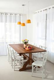 reclaimed wood trestle with fruit bowl dining room rustic and cage pendant lights