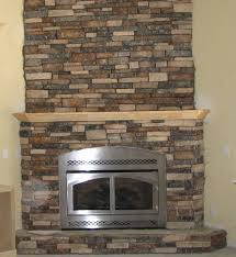fabricated stone fireplace in corner