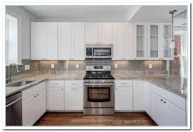 stylish white kitchen cabinet ideas featuring perning to decorations 15