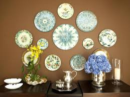 plates eclectic dining room with wall art plates on plate wall art ideas with great ideas for 3 d wall art that aren t antlers hgtv s decorating