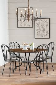 french inspired dining table. primitive peacock chair dining french inspired table