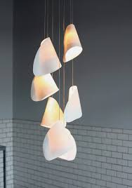 porcelain lighting. a strong contrast is established between the organically distributed soft light passing through translucent white porcelain skin and sharp lighting t