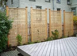 Here are tall rectangular cedar lattice privacy panels.