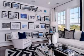 Wall Hanging Ideas - Pictures leaning against a wall supported by a shelf.