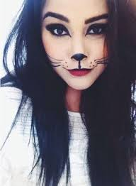 i m going to be a cat and dress in all black and do this makeup and i m also going with a big group of friends