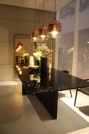copper pendant lights over dining table