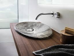 modern bathroom sinks. This Modern Bathroom Sink Made From Natural Stone Sits On A Floating Wood Vanity And Has Sinks E