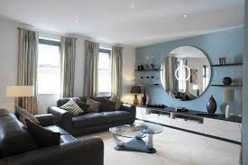 Stunning accent wall with round mirror