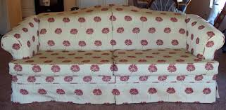 under this pretty new slipcover is a tired looking blue plaid fabric with colonial wood trim