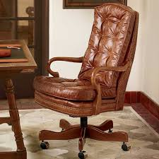custom made leather office chair with wood arms and legs with wheels featuring intricate leather pattern on top and base border specifications wi